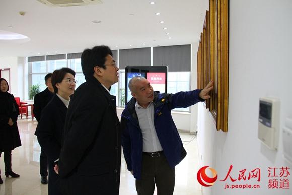 南京玄武区委书记李世峰到访人民日报江苏分社